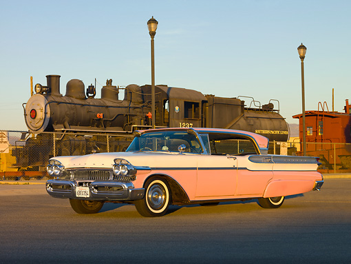 AUT 21 RK2319 01 © Kimball Stock 1957 Mercury Turnpike Cruiser White And Pink 3/4 Front View On Pavement By Train