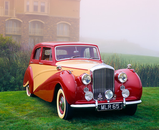 AUT 21 RK2320 01 © Kimball Stock 1951 Bentley Mk VI Harold Radford Countryman Saloon Maroon & Tan 3/4 Front View On Grass