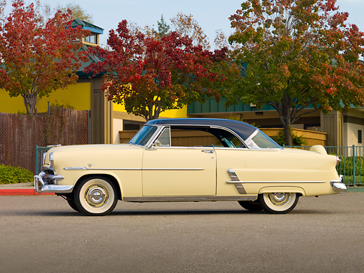 AUT 21 RK2322 01 © Kimball Stock 1953 Ford Crestline Victoria Ivory And Blue Profile View On Pavement By Trees