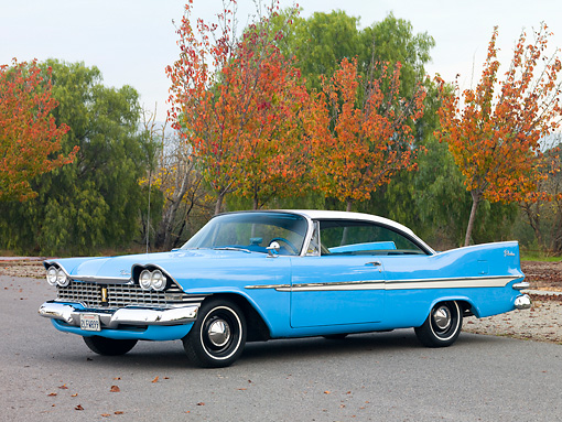 AUT 21 RK2324 01 © Kimball Stock 1959 Plymouth Belvedere Blue And White 3/4 Front View On Pavement By Trees