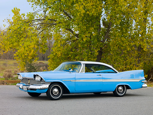 AUT 21 RK2325 01 © Kimball Stock 1959 Plymouth Belvedere Blue And White 3/4 Front View On Pavement By Trees