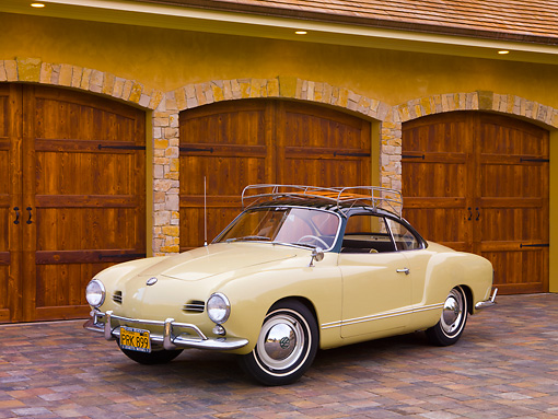 AUT 21 RK2347 01 © Kimball Stock 1958 Volkswagen Karmann Ghia Beige 3/4 Front View On Driveway By House