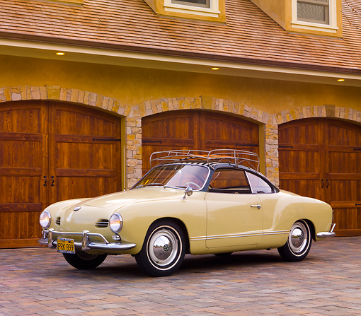 AUT 21 RK2349 01 © Kimball Stock 1958 Volkswagen Karmann Ghia Beige 3/4 Front View On Driveway By House