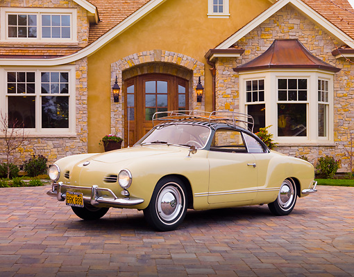 AUT 21 RK2351 01 © Kimball Stock 1958 Volkswagen Karmann Ghia 2+2 Coupe Beige 3/4 Front View On Driveway By House