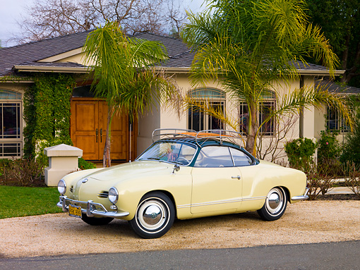 AUT 21 RK2353 01 © Kimball Stock 1958 Volkswagen Karmann Ghia Beige 3/4 Front View On Gravel By House