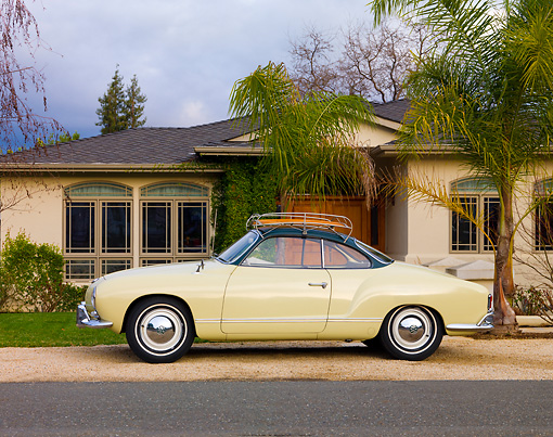 AUT 21 RK2354 01 © Kimball Stock 1958 Volkswagen Karmann Ghia Beige Profile View On Gravel By House