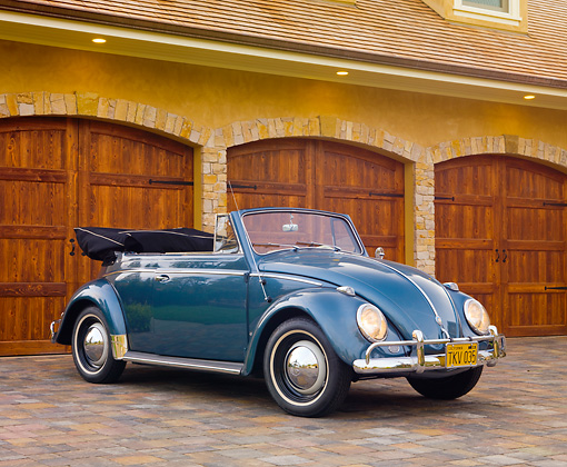 AUT 21 RK2357 01 © Kimball Stock 1959 Volkswagen Cabriolet Beetle Blue 3/4 Front View On Driveway By House