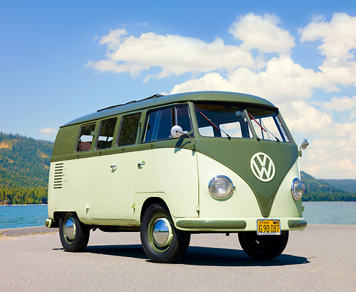 AUT 21 RK2397 01 © Kimball Stock 1957 Volkswagen Bus Green And Light Green 3/4 Front View On Pavement
