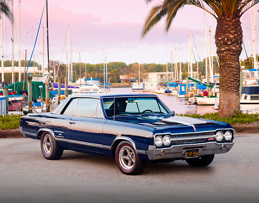 AUT 22 BK0009 01 © Kimball Stock 1965 Oldsmobile 442 Dark Blue 3/4 Front View On Pavement By Marina
