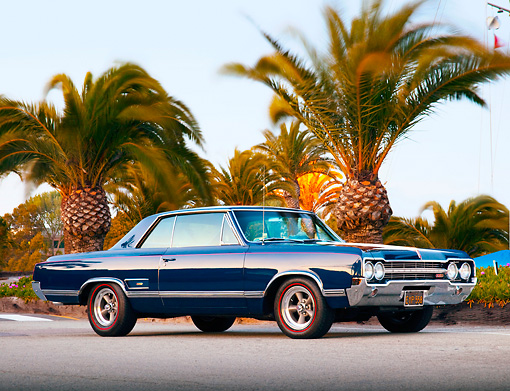 AUT 22 BK0011 01 © Kimball Stock 1965 Oldsmobile 442 Dark Blue 3/4 Front View On Pavement By Marina