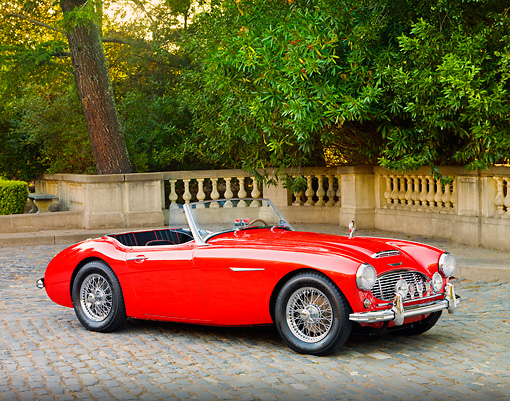 AUT 22 BK0012 01 © Kimball Stock 1960 Austin-Healey 3000 BT7 Roadster Red 3/4 Front View On Pavement By Trees