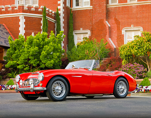AUT 22 BK0014 01 © Kimball Stock 1960 Austin-Healey 3000 BT7 Roadster Red 3/4 Front View On Pavement By Mansion