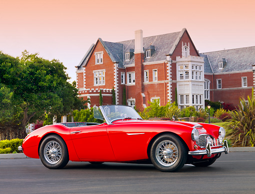 AUT 22 BK0015 01 © Kimball Stock 1960 Austin-Healey 3000 BT7 Roadster Red 3/4 Front View On Pavement By Mansion