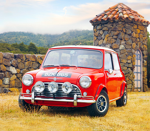 AUT 22 BK0016 01 © Kimball Stock 1960 Mini Mark I Red 3/4 Front View On Dry Grass By Stone Wall