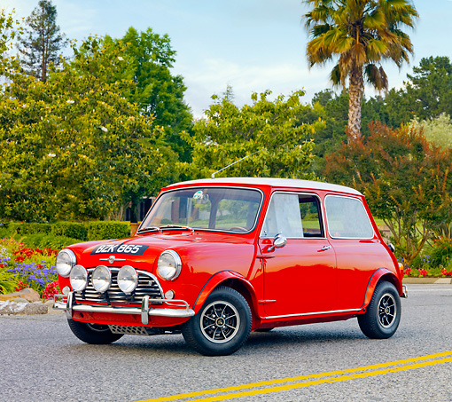AUT 22 BK0019 01 © Kimball Stock 1960 Mini Mark I Red 3/4 Front View On Pavement By Trees