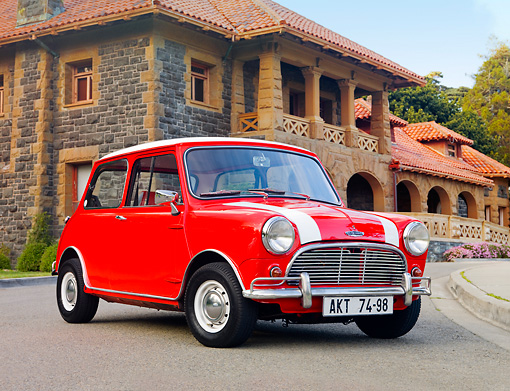 AUT 22 BK0023 01 © Kimball Stock 1961 Mini Mark I Red With White Stripes 3/4 Front View On Pavement By Building