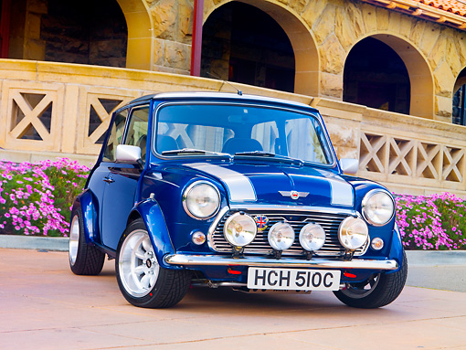 AUT 22 BK0030 01 © Kimball Stock 1965 Mini Blue With Silver Stripes 3/4 Front View On Pavement By Building