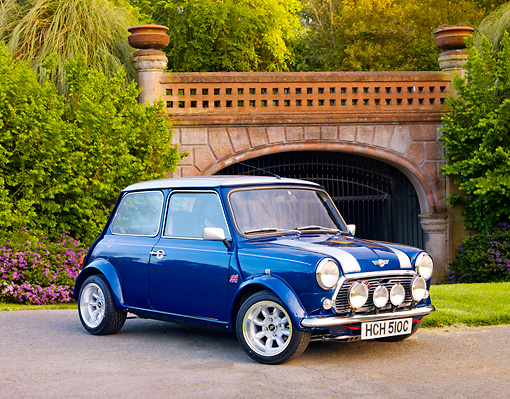 AUT 22 BK0033 01 © Kimball Stock 1965 Mini Blue With Silver Stripes 3/4 Front View On Pavement By Bridge