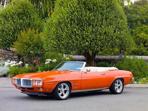 AUT 22 BK0048 01 © Kimball Stock 1969 Pontiac Firebird Convertible Orange 3/4 Front View On Pavement By Trees