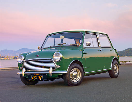 AUT 22 BK0085 01 © Kimball Stock 1967 Austin Mini Cooper Mark II Green 3/4 Front View On Pavement By Water At Dusk