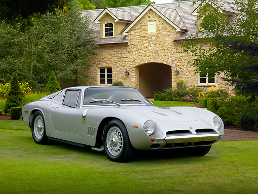AUT 22 BK0087 01 © Kimball Stock 1965 Bizzarrini 5300 GT Strada Silver 3/4 Front View On Grass By House