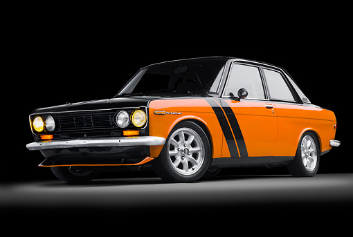 AUT 22 BK0089 01 © Kimball Stock 1969 Datsun 510 Orange And Black 3/4 Front View In Studio
