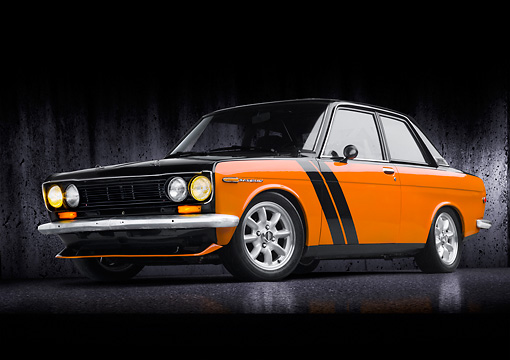 AUT 22 BK0090 01 © Kimball Stock 1969 Datsun 510 Orange And Black 3/4 Front View In Studio