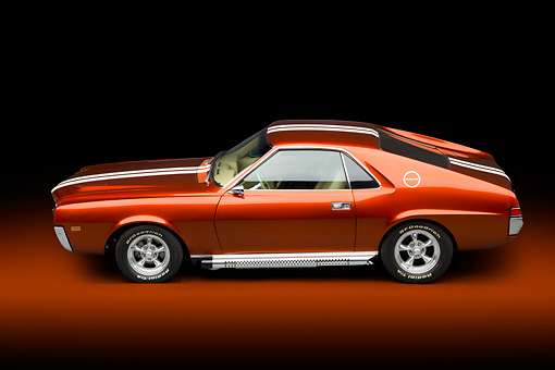 AUT 22 BK0101 01 © Kimball Stock 1969 AMC AMX Candy Tangerine With White Stripes Profile View In Studio