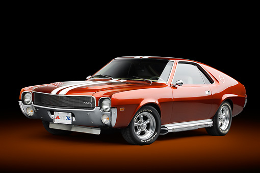 AUT 22 BK0103 01 © Kimball Stock 1969 AMC AMX Candy Tangerine With White Stripes 3/4 Front View In Studio