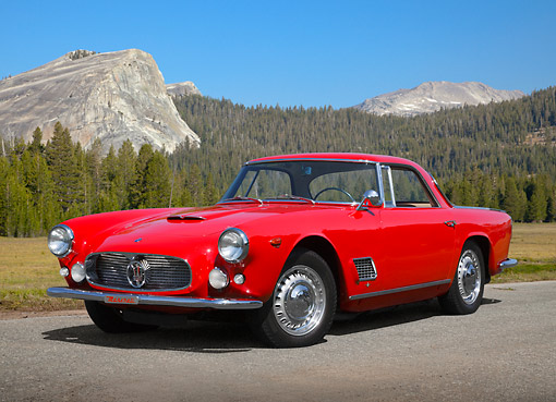 AUT 22 BK0112 01 © Kimball Stock 1960 Maserati 3500 GT Red 3/4 Front View On Pavement In Mountains
