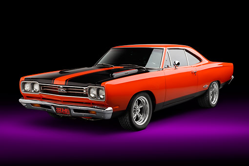 AUT 22 BK0125 01 © Kimball Stock 1969 Plymouth GTX Orange With Black Stripes 3/4 Front View In Studio