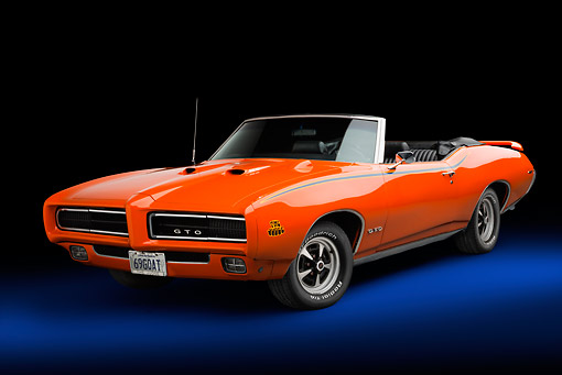AUT 22 BK0126 01 © Kimball Stock 1969 Pontiac GTO Judge Orange 3/4 Front View In Studio