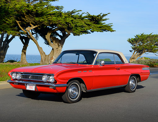 AUT 22 BK0128 01 © Kimball Stock 1962 Buick Skylark Red 3/4 Front View On Pavement By Water