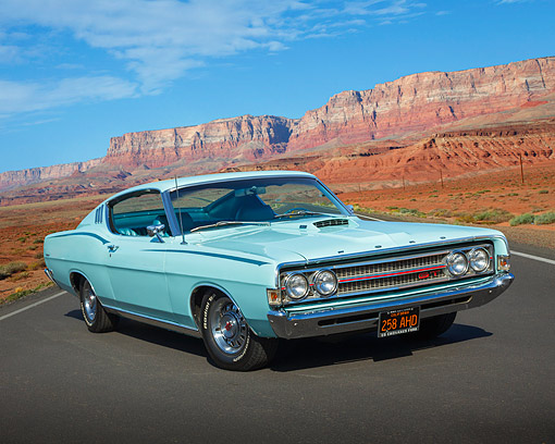 AUT 22 BK0129 01 © Kimball Stock 1969 Ford Torino GT Aqua Blue 3/4 Front View On Road In Desert