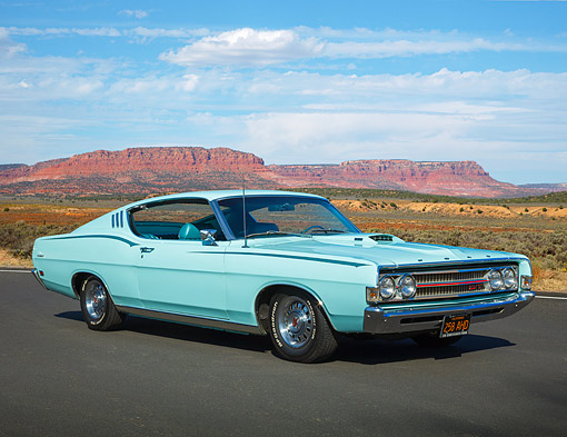 AUT 22 BK0130 01 © Kimball Stock 1969 Ford Torino GT Aqua Blue 3/4 Front View On Road In Desert