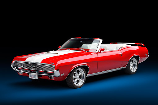 AUT 22 BK0539 01 © Kimball Stock 1969 Mercury Cougar XR-7 Convertible Red And White 3/4 Front View In Studio