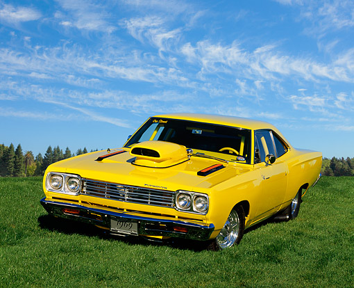 AUT 22 RK0009 02 © Kimball Stock 1969 Plymouth Road Runner Yellow 3/4 Front View On Grass With Trees In Background