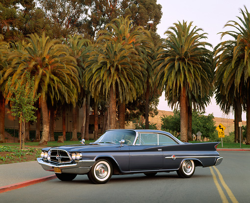 AUT 22 RK0047 08 © Kimball Stock 1960 Chrysler 300F Sport Coupe 3/4 Side View On Road By Palm Trees