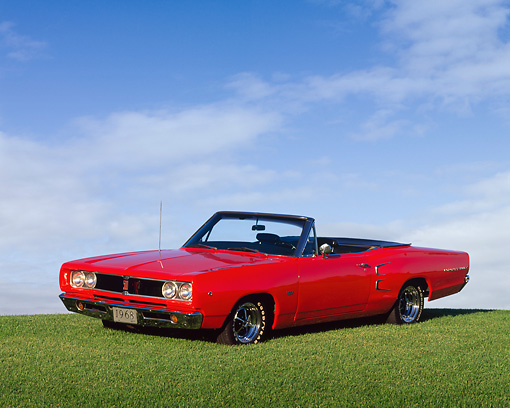 AUT 22 RK0063 04 © Kimball Stock 1968 Dodge Coronet 500 Convertible Red Low 3/4 Side View On Grass Hill