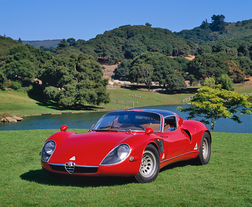 AUT 22 RK0106 03 © Kimball Stock 1968 Alfa Romeo Type 33 Stradale Red 3/4 Front View On Grass By Water