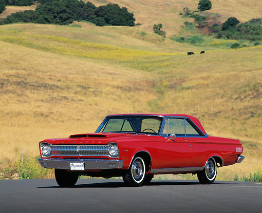 AUT 22 RK0126 01 © Kimball Stock 1965 Plymouth Satellite Red 3/4 Front View On Road