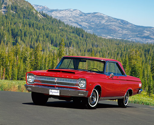 AUT 22 RK0128 03 © Kimball Stock 1965 Plymouth Satellite Red 3/4 Front View On Road By Hills
