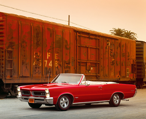 AUT 22 RK0151 01 © Kimball Stock 1965 Pontiac GTO Convertible Red 3/4 Side View By Train