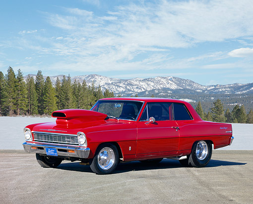 AUT 22 RK0197 03 © Kimball Stock 1966 Chevrolet Nova Red 3/4 Side View On Pavement Hills Background