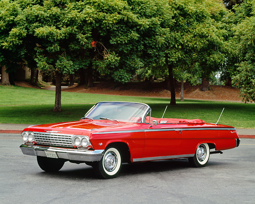 AUT 22 RK0245 05 © Kimball Stock 1962 Chevrolet Impala Super Sport Convertible1 Red 3/4 Side View On Pavement By Trees