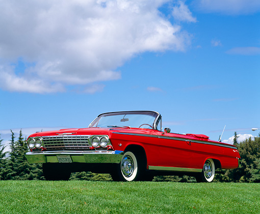 AUT 22 RK0246 02 © Kimball Stock 1962 Chevrolet Impala Super Sport Convertible Red 3/4 Low Front View On Grass