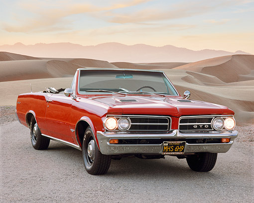 AUT 22 RK0270 08 © Kimball Stock 1964 Pontiac GTO Convertible Red 3/4 Front View On Gravel By Sand Dunes