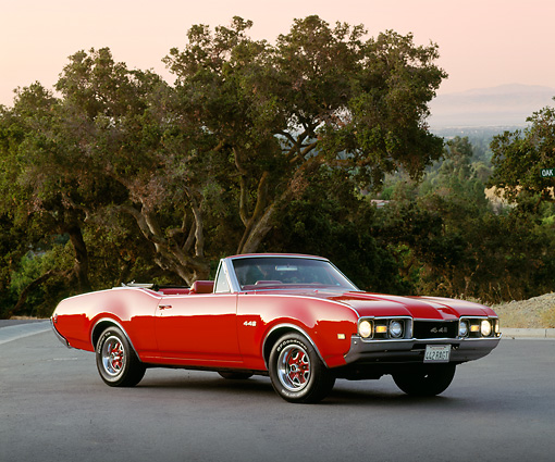 AUT 22 RK0297 05 © Kimball Stock 1968 Oldsmobile 442 Convertible Red 3/4 Side View On Pavement