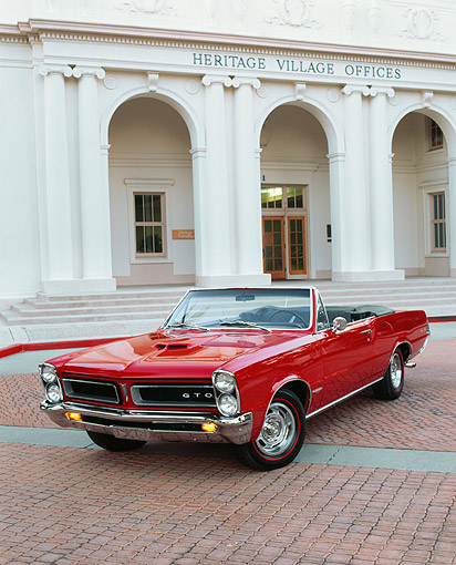 AUT 22 RK0460 04 © Kimball Stock 1965 Pontiac GTO Convertible Red 3/4 Front View On Pavement