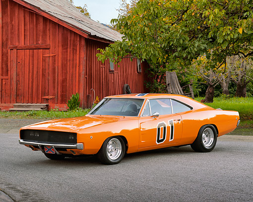 AUT 22 RK0973 01 © Kimball Stock 1969 Dodge Charger 440 Orange 3/4 Front View On Pavement By Barn And Trees
